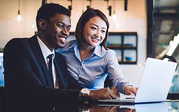 iMeta Technologies multiracial colleagues watching video on laptop